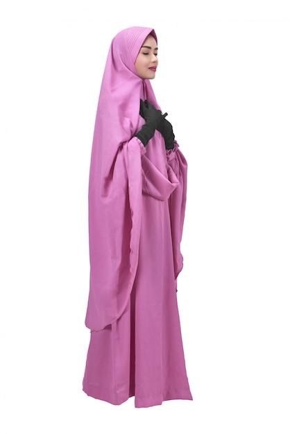 ベールの祈りで美しいアジアのイスラム教徒の女性 Premium写真