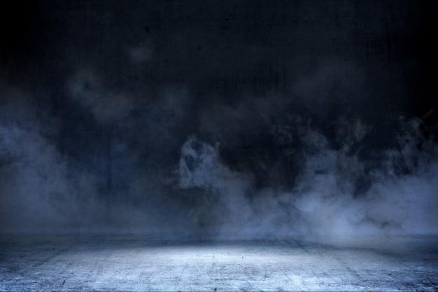 コンクリートの床と煙の背景付きの部屋 Premium写真