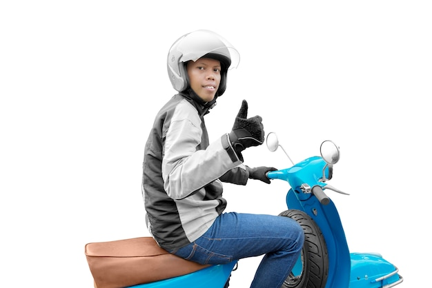 親指を現して彼のバイクを持つアジアバイクタクシー男 Premium写真