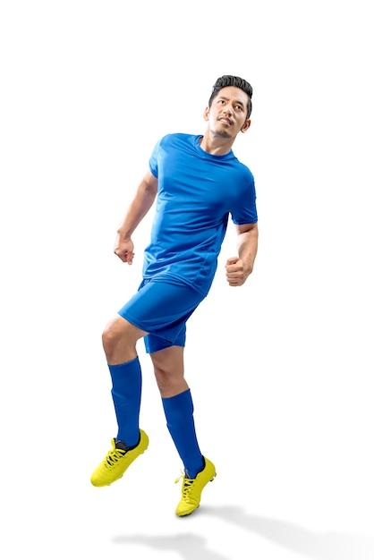 Азиатский футболист человек в действии Premium Фотографии