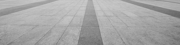 通り道路の地面にモノトーングレーレンガ石の斜視図。 Premium写真