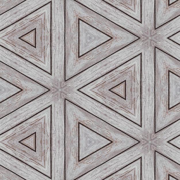 Иллюстративный рисунок из деревянных планок в виде треугольников и линий. Premium Фотографии