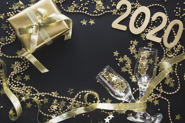 黒にグラスシャンパンとゴールデンギフトボックス Premium写真