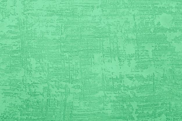 Текстурированная шпаклевка на стену. грубый гранж стены фон. Premium Фотографии