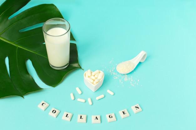 コラーゲンパウダー、ミルク、青の丸薬。 Premium写真