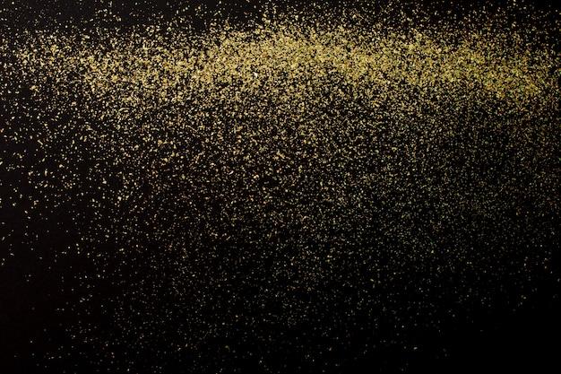 Рождество золотой глиттер на черном фоне. праздник аннотация Premium Фотографии