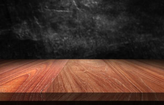 暗い背景をぼかした写真を木製のテーブル。 Premium写真