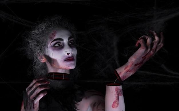 Девушка и хэллоуин и маска Premium Фотографии