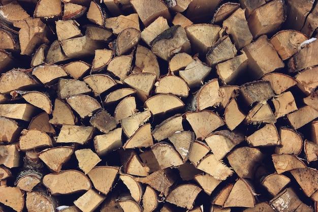 ログの終わり木製の背景。調色。スタック内の木。 Premium写真