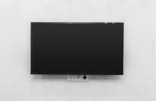 壁にテレビを率いて Premium写真