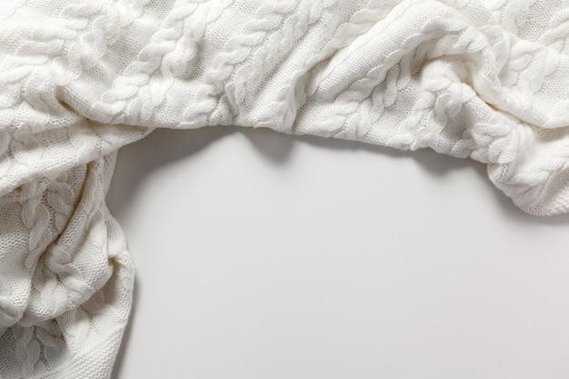 ホワイトウールセーターの背景 Premium写真