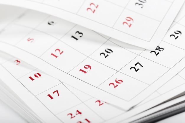 カレンダーページを閉じるビジネス時間の概念 Premium写真