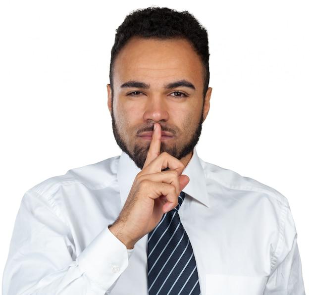 Парень с пальцем на губах Premium Фотографии