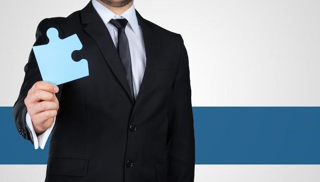 認識できない実業家持株パズルのピース。事業コンセプト Premium写真
