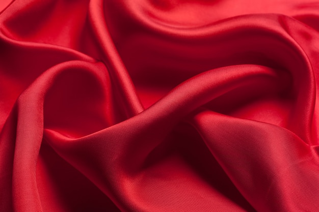 赤い布の波表面の質感 Premium写真