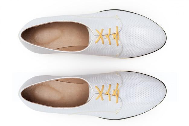 白で隔離されるブーツ Premium写真
