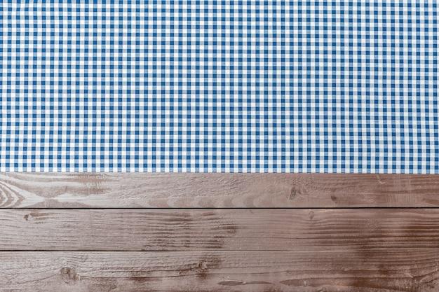 木製の背景にテーブルクロス繊維 Premium写真