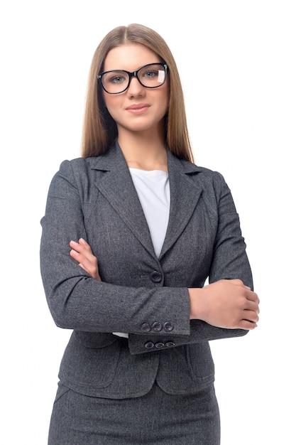 Молодая усмехаясь коммерсантка изолированная Premium Фотографии
