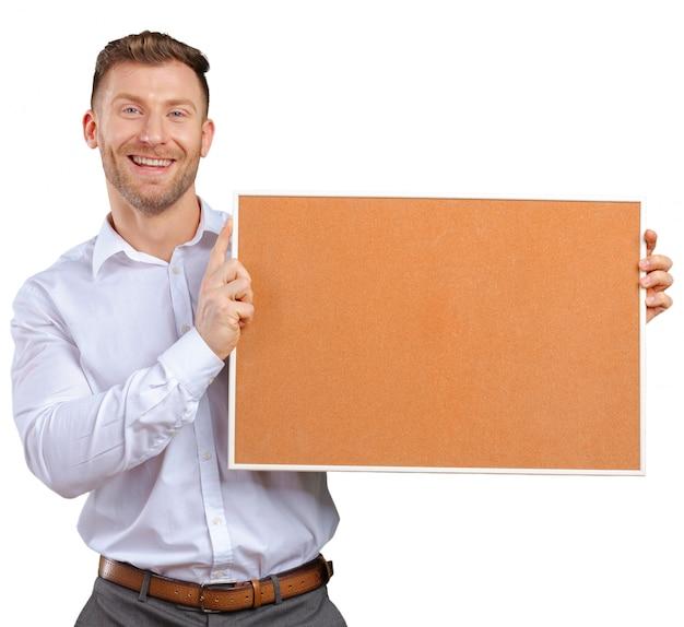 コルクボードを保持している実業家 Premium写真
