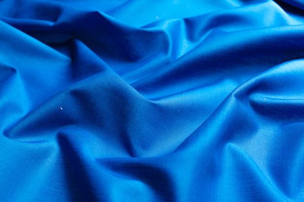 青い絹の布の背景 Premium写真