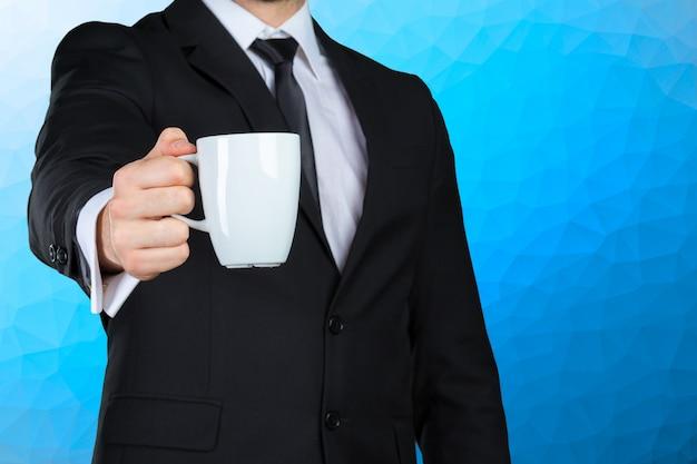 Крупный план с рукой бизнесмена держа кофе Premium Фотографии