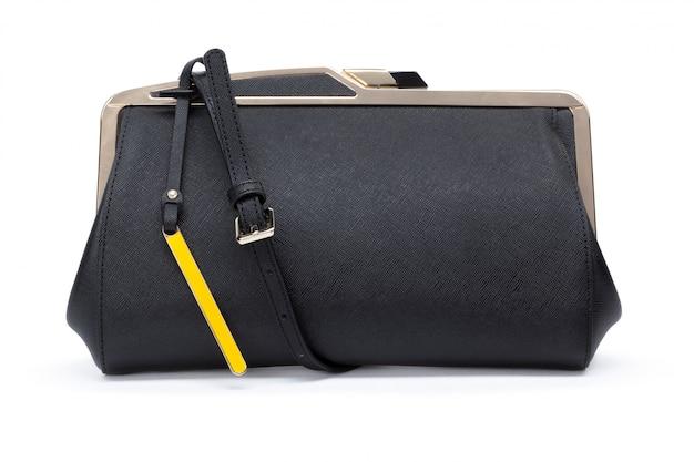 白で隔離される女性のバッグのクローズアップ Premium写真