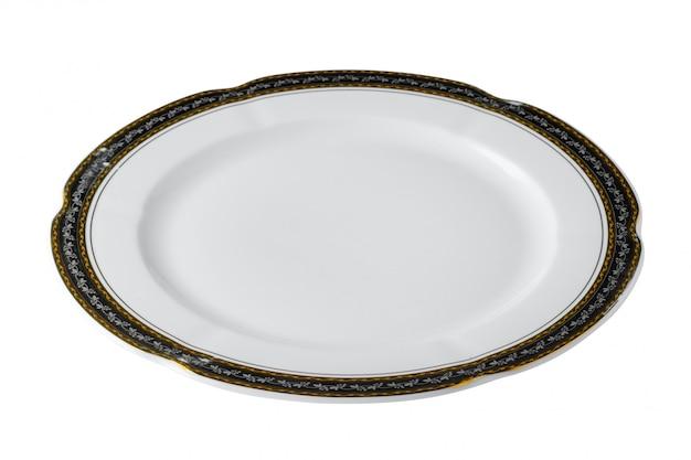 Белая керамическая тарелка с золотой каймой на белом фоне Premium Фотографии