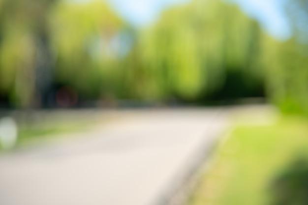 背景の抽象的なぼかし都市公園ボケ Premium写真
