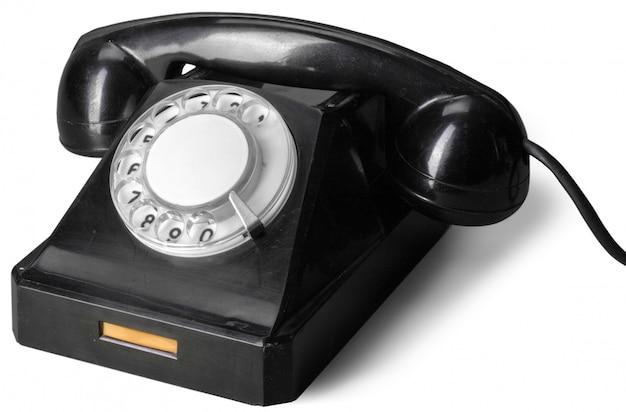 白い背景で隔離の古い電話 Premium写真