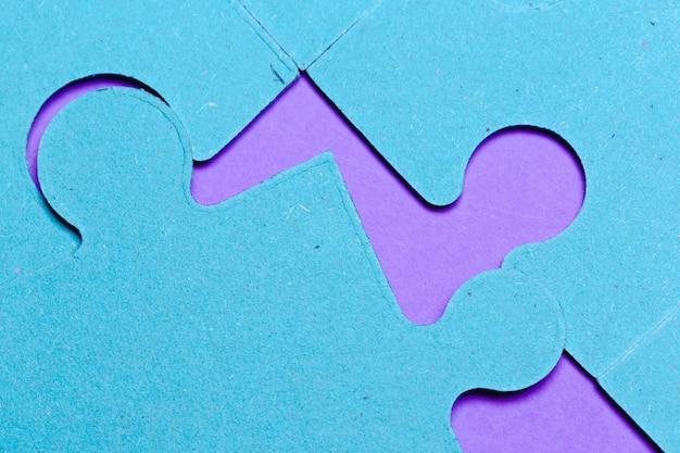 Концепция головоломки, синий фон Premium Фотографии