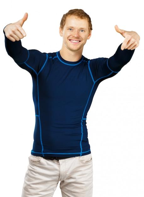 Дружелюбный приятный человек в спортивном наряде на белом фоне Premium Фотографии