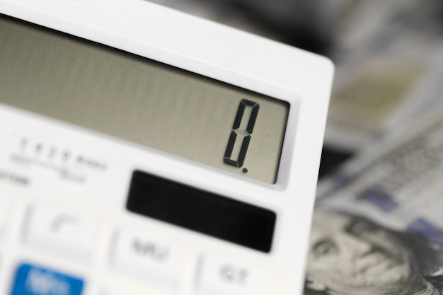 Калькулятор и деньги Premium Фотографии