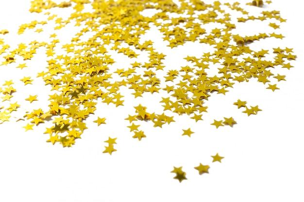 白い背景の上の星のパーティーの装飾 Premium写真