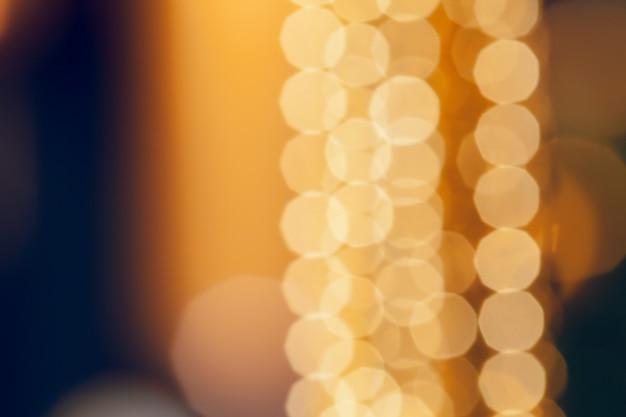 クリスマス輝く黄金背景。 Premium写真