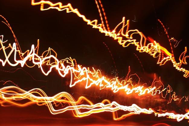 抽象的な背景とトレースされた光る線のテクスチャ。 Premium写真