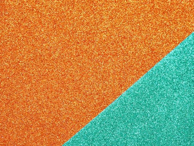 オレンジ色のターコイズブルーの輝きの抽象的な背景。 Premium写真