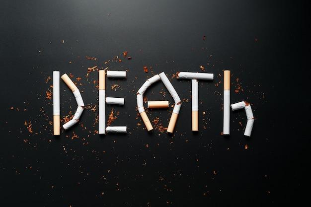 タバコからの碑文の死。禁煙します。喫煙の概念は殺します。喫煙をやめるための動機碑文、不健康な習慣。 Premium写真