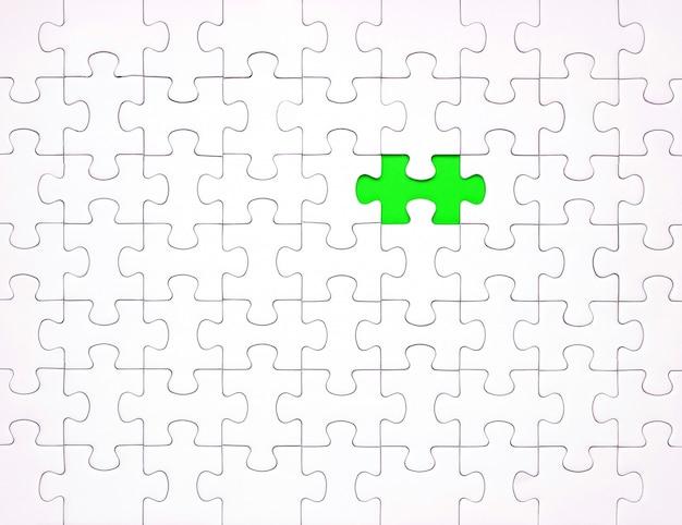 青の背景に白のパズルのピース。コンテンツの背景 Premium写真