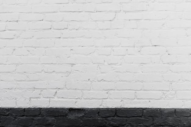 繊細なケラレと古いれんが造りの壁テクスチャの白 Premium写真