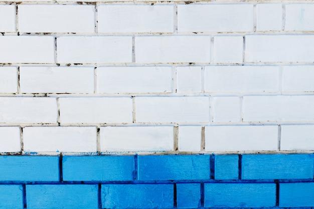抽象的な垂直モダンな正方形の白いレンガタイルの壁のテクスチャ。青色 Premium写真