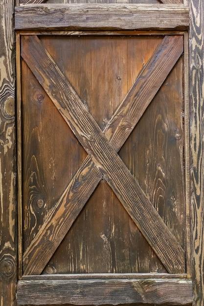 木製のドアロック、ヴィンテージの木製のドア、茶色のドア、テクスチャ、背景。 Premium写真