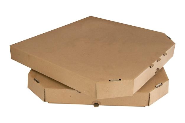 分離されたピザの箱のスタック。茶色の段ボールを閉じた。 Premium写真