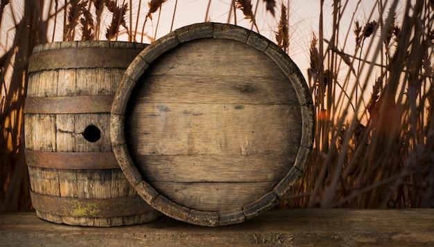 バレルと小麦の背景の着用の古いテーブルの背景 Premium写真