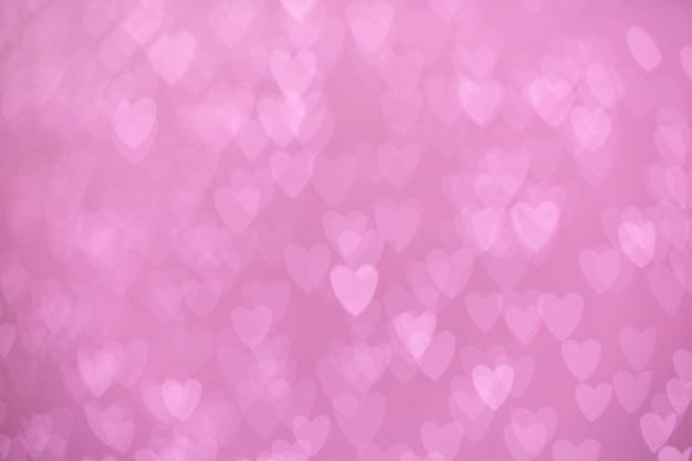 ピンクの心の多重ライト背景のボケ味 Premium写真