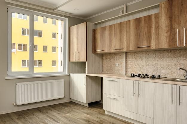 モダンなベージュのキッチン Premium写真