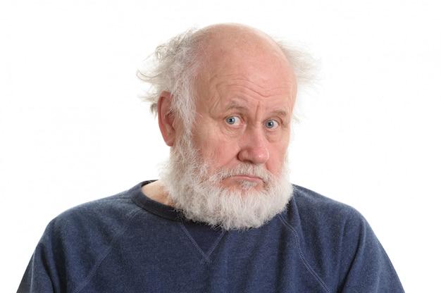 悲しい憂鬱な老人の孤立した肖像画 Premium写真