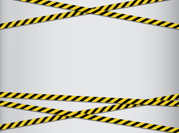 注意と危険のテープ。警告テープ黒と黄色の縞模様。 Premium写真
