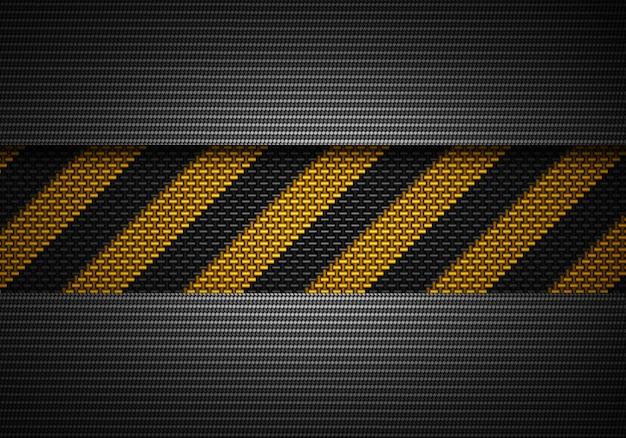 Абстрактный черный углерод текстурированный материал дизайн с предупреждением ленты Premium Фотографии