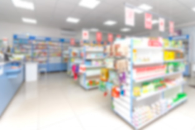 Аннотация размытие полки с лекарствами и другими товарами в аптеке магазине Premium Фотографии