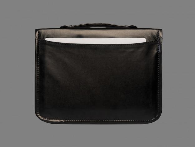 灰色の背景に分離されたドキュメントのクローズアップと黒革のブリーフケース Premium写真